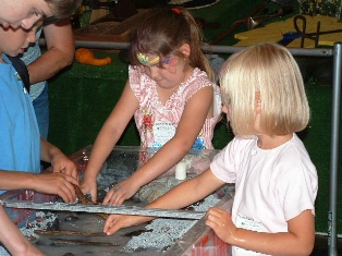 Kids learning about watershed at fair booth
